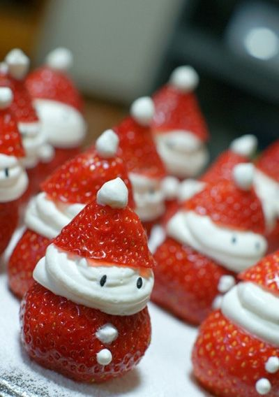 Strawberry Santas! Here's a cool idea for the kids at Christmas: little Father Christmases made with whipped cream and fresh strawberries (still in season in South Africa!):